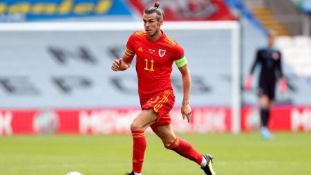 Gareth Bale meneruskan catatan buruk yang dimiliki oleh pemain Real Madrid di gelaran Euro usai eksekusi penaltinya melenceng jauh dan gagal menemui sasaran. - INDOSPORT