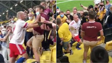 Brutal bak petarung jalanan, bek Hamburger SV yang bernama Toni Leistner nekat menyerang suporter lawan di atas tribun. - INDOSPORT