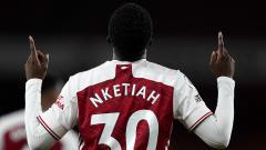 Indosport - Selebrasi gol pemain Arsenal, Edie Nketiah, dalam pertandingan Liga Inggris versus West Ham United, Sabtu (19/9/20).