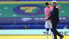 Indosport - James Rodriguez dan Carlo Ancelotti usai Everton menghancurkan West Bromwich Albion