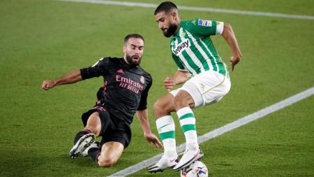 Bersiap-siap ditinggalkan oleh Hakan Calhanoglu, AC Milan dikabarkan tengah melakukan pendekatan dengan bintang andalan Real Betis. - INDOSPORT