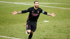 Indosport - Sergio Ramos melakukan selebrasi usai mencetak gol untuk Real Madrid ke gawang Real Betis
