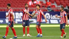 Indosport - Selebrasi pemain Atletico Madrid usai mengalahkan Granada