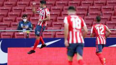 Indosport - Selebrasi Luis Suarez usai mencetak gol dalam laga Atletico Madrid vs Granada