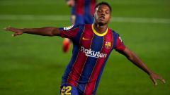 Indosport - Selebrasi Ansu Fati usai mencetak gol untuk Barcelona ke gawang Villarreal
