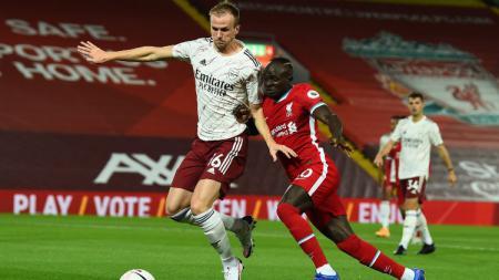Link Live Streaming 16 Besar Carabao Cup antara Liverpool vs Arsenal di Mola TV pada Jumat (2/10/2020) pukul 01.45 dini hari WIB. - INDOSPORT