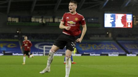 Scott McTominay merayakan golnya dalam laga Brighton vs Manchester United - INDOSPORT