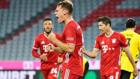 Selebrasi Joshua Kimmich usai mencetak gol kemenangan Bayern Munchen atas Borussia Dortmund - INDOSPORT