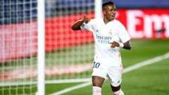 Indosport - Selebrasi Vinicius Junior usai mencetak gol kemenangan Real Madrid atas Valladolid