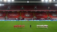 Indosport - Momen Divock Origi gagal mencetak gol di adu penalti antara Liverpool vs Arsenal