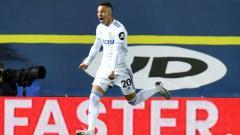 Indosport - Rodrigo Moreno berselebrasi usai mencetak gol di laga Leeds United vs Manchester City