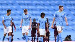 Indosport - Pemain Manchester City terlihat sedih saat pertandingan Liga Inggris antara Manchester City dan Leicester City