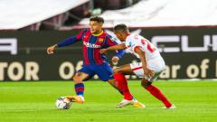 Indosport - Aksi Philippe Coutinho di laga melawan Sevilla