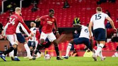 Indosport - Laga Liga Inggris antara Manchester United vs Tottenham Hotspur