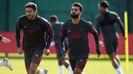 Marko Grujic (kiri) kabarnya minta dijual oleh manajemen Liverpool ke klub Bundesliga Jerman, Hertha Berlin. - INDOSPORT