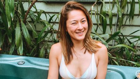 Pebulutangkis cantik Australia, Gronya Somerville, membuat netizen dan juga Ratchanok Intanon terkesima dengan sebuah tarian perut. - INDOSPORT