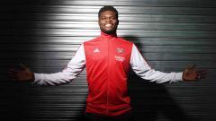 Indosport - Thomas Partey akhirnya menjalani debutnya bersama Arsenal. Ia pun berpotensi mengikuti jejak 5 bintang terbaik The Gunners yang berasal dari Afrika.
