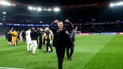 Indosport - Selebrasi pelatih Manchester United, Ole Gunnar Solskjaer, saat mengalahkan PSG di Liga Champions 2018/2019.