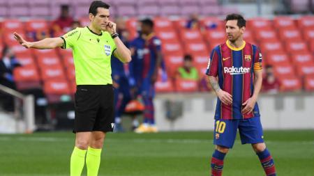 Aksi Lionel Messi di laga Barcelona vs Real Madrid dalam lanjutan Liga Spanyol. - INDOSPORT