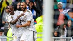 Indosport - Hubungan dua penyerang Real Madrid, Karim Benzema dan Vinicius Junior mulai membaik.