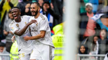 Hubungan dua penyerang Real Madrid, Karim Benzema dan Vinicius Junior sudah membaik. - INDOSPORT