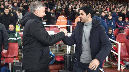 Pelatih Manchester United, Ole Gunnar Solskjaer dan pelatih Arsenal, Mikel Arteta. - INDOSPORT