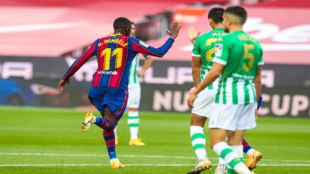 Ousmane Dembele merayakan gol yang ia buat ke gawang Real Betis - INDOSPORT
