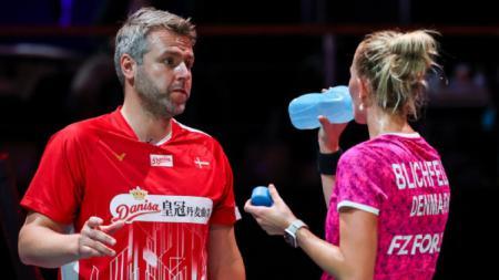 Asisten pelatih bulutangkis Denmark, Jesper Hovgaard angkat suara soal perbedaan komitmen antara pebulutangkis muda Asia dan Denmark. - INDOSPORT