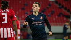 Indosport - Phil Foden merayakan gol Manchester City atas Olympiacos di Liga Champions