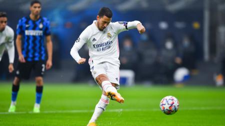 Eden Hazard saat mengeksekusi tendangan penalti di laga Inter Milan vs Real Madrid - INDOSPORT