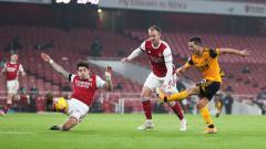 Indosport - Pemain Wolves, Daniel Podence, mencetak gol ke gawang Arsenal pada pertandingan Liga Inggris, Senin (30/11/20) dini hari WIB.