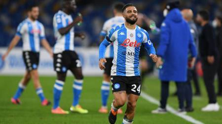 Pemain Napoli, Lorenzo Insigne, merayakan golnya ke gawang AS Roma dalam pertandingan Liga Italia, Senin (30/11/20) dini hari WIB. - INDOSPORT