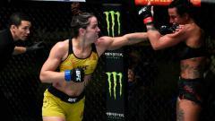 Indosport - Wasit UFC, Jason Herzog mendapatkan banjir pujian karena sempat menghentikan duel saat bra seorang petarung wanita, Norma Dumont Viana, melorot kala  menghadapi Ashlee Evans-Smith.