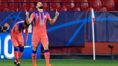 Indosport - Selebrasi Olivier Giroud dalam laga Sevilla vs Chelsea