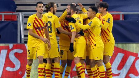 Antoine Griezmann selebrasi usai mencetak gol untuk Barcelona di Liga Champions. - INDOSPORT