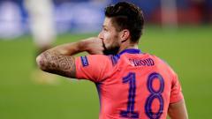 Indosport - Olivier Giroud selebrasi usai mencetak quattrick di laga Liga Champions Sevilla vs Chelsea