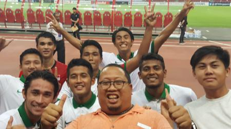 Muly Munial bersama para pemainnya. - INDOSPORT