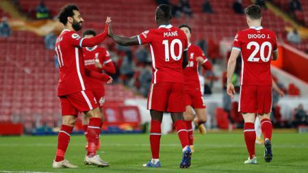 Tampil di depan penonton berjumlah terbatas di Anfield, Liverpool menang telak 4-0 atas Wolverhampton di Liga Inggris. Ada 4 catatan menarik di balik hasil itu. - INDOSPORT