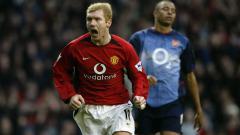 Indosport - Selebrasi emosional gelandang Manchester United, Paul Scholes, usai membobol gawang Arsenal dalam pertandingan Liga Inggris, 7 Desember 2002.