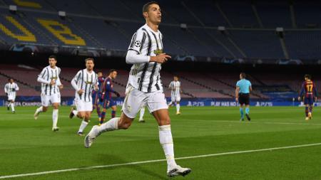 Selebrasi Cristiano Ronaldo usai mencetak gol di laga Barcelona vs Juventus - INDOSPORT