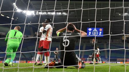 Ekspresi kekecewaan Harry Maguire di laga RB Leipzig vs Manchester United - INDOSPORT