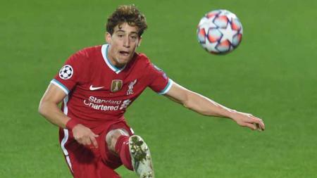 Kostas Tsimikas sepertinya mulai meraih hati Jurgen Klopp di klub Liga Inggris, Liverpool. - INDOSPORT