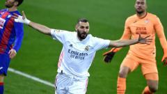 Indosport - Karim Benzema (Real Madrid) saingi Lionel Messi di daftar top skor sementara LaLiga Spanyol musim ini.