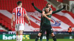 Indosport - Selebrasi gol Gareth Bale di laga Stoke City vs Tottenham Hotspur.