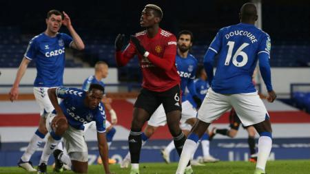 Manchester United berpotensi kehilangan sejumlah pemain bintang yang kontraknya segera berakhir, termasuk Paul Pogba. - INDOSPORT