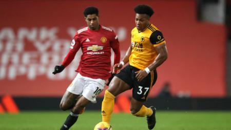 Aksi Marcus Rashford dan Adama Traore di laga Liga Inggris Manchester United vs Wolves. - INDOSPORT