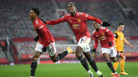 Termasuk Paul Pogba, lima pemain bintang Manchester United siap comeback dan merepotkan AC Milan di pertandingan leg kedua babak 16 besar Liga Europa. - INDOSPORT