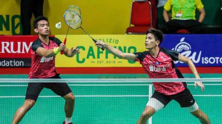 Belum tampil maksimal di kompetisi Swiss Open 2021, asisten pelatih ganda putra PBSI, Aryono Miranat berikan evaluasi kepada dua wakil Indonesia. - INDOSPORT