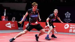 Indosport - Menang dari Leo Rolly Carnando/Daniel Marthin di perempat final Swiss Open 2021, media Malaysia sebut Aaron Chia/Soh Wooi Yik menyelamatkan ini. Apa itu?