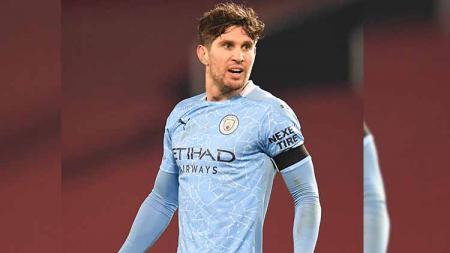 John Stones mulai menunjukkan tanda kebangkitan bersama Manchester City. - INDOSPORT
